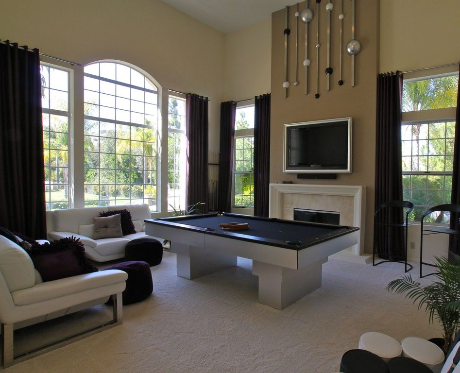 Contemporary game room with high ceiling rizzy home shag - How high to mount tv in living room ...