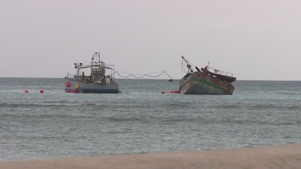 Grounded Fishing Boat Still Stuck Off Waikiki Beach