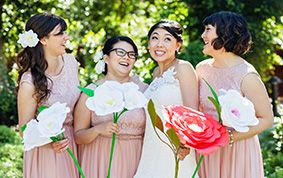 Unique paper flowers gave this bridal party a pretty and chic flair #Disneyland #wedding #paper #flower