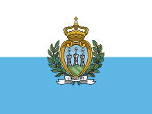 Flag of San Marino. | San Marino claims to be the oldest surviving sovereign state and constitutional republic in the world, as the continuation of the monastic community founded on 3 September 301, by stonecutter Marinus of Arba. Legend has it that Marinus left Rab, then the Roman colony of Arba, in 257 when the future emperor, Diocletian, issued a decree calling for the reconstruction of the city walls of Rimini, which had been destroyed by Liburnian pirates.