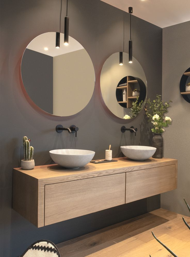 A customized, solid oak bathroom furniture. Combined with atmospheric LoooX lamp…