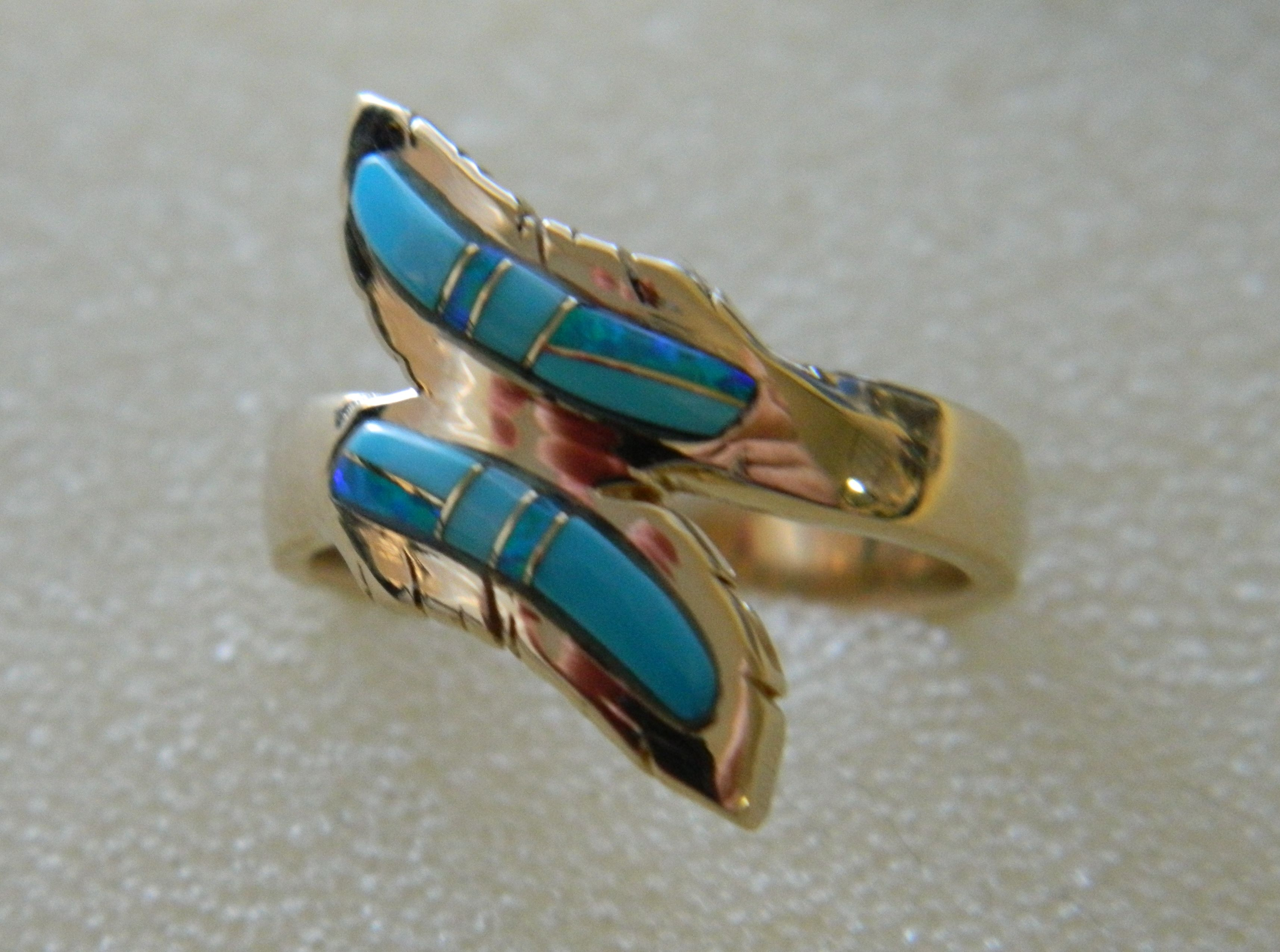 T243 with sleeping beauty turquoise and blue opal