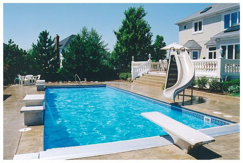 rectangle pool with slide and diving board