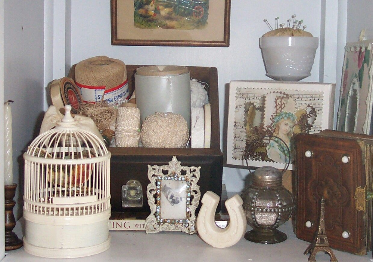 """Just a little vignette from one of my """"cubbies""""  where I arrange what inspires me or the supplies I use a lot. In the front is a tiny picture of my beloved pug, NeeNee, who live to be 17!"""