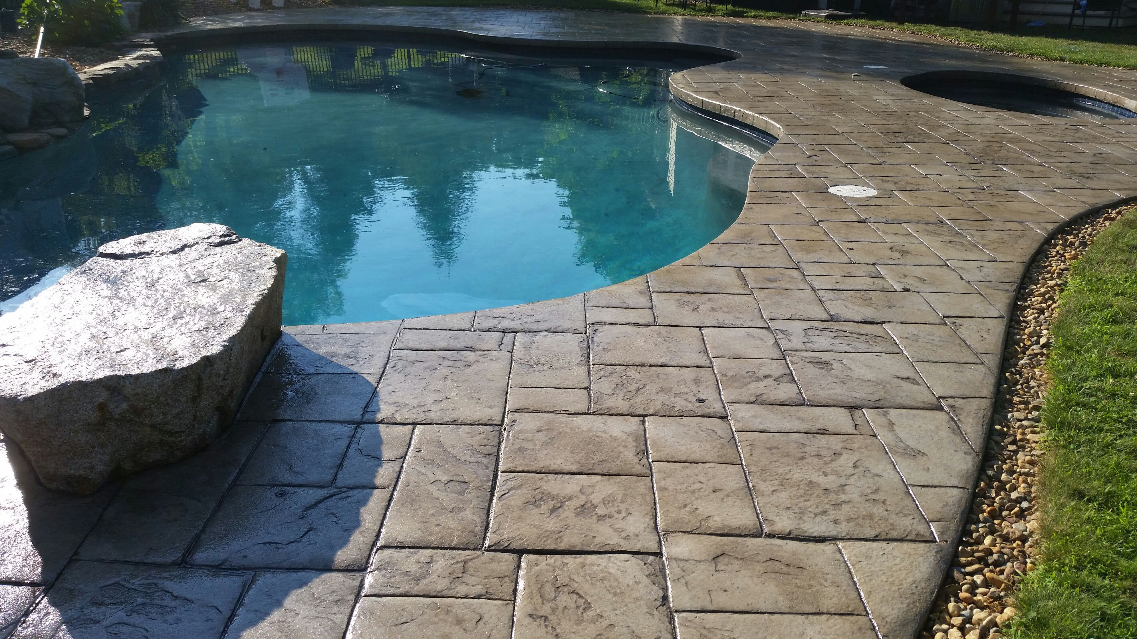 Stamped Concrete Pool Deck Sealed With The Foundation Armor AR350 Wet Look  Sealer.