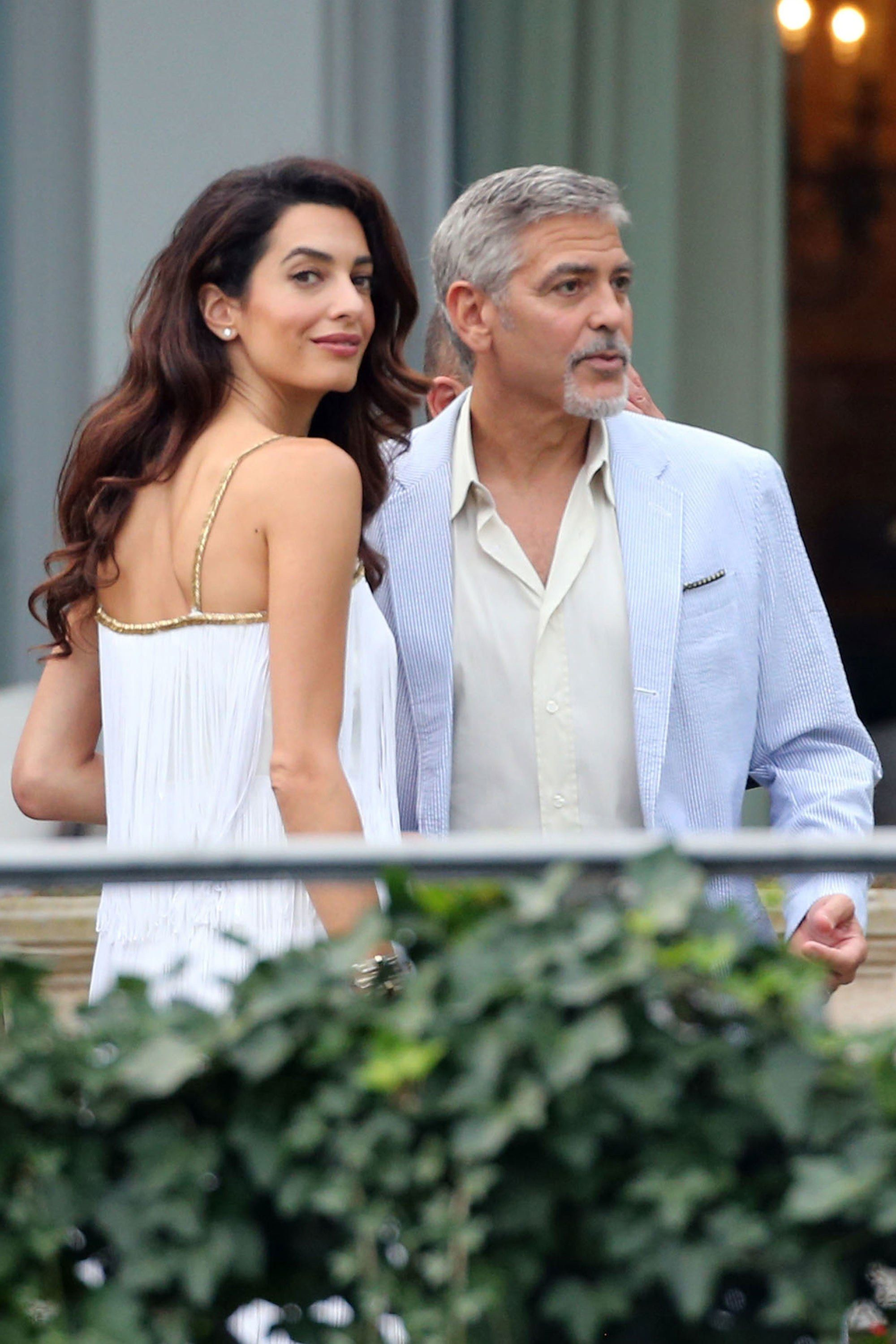 George And Amal Clooney S Twins Spotted In Public For The First Time On A Private Jet To Italy Amal Clooney Celebrity Style Celebrities
