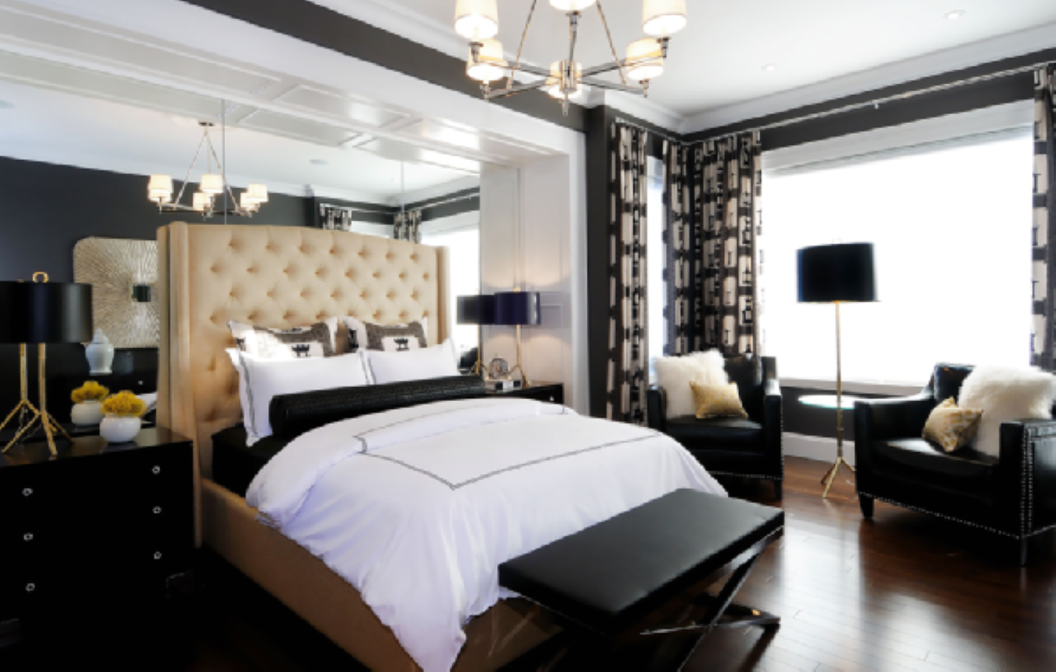 An exclusive bedroom interior design beautified by mirrored wall