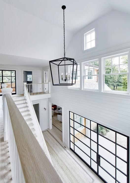 Cottage home features a two-story foyer boasting shiplap trim ...