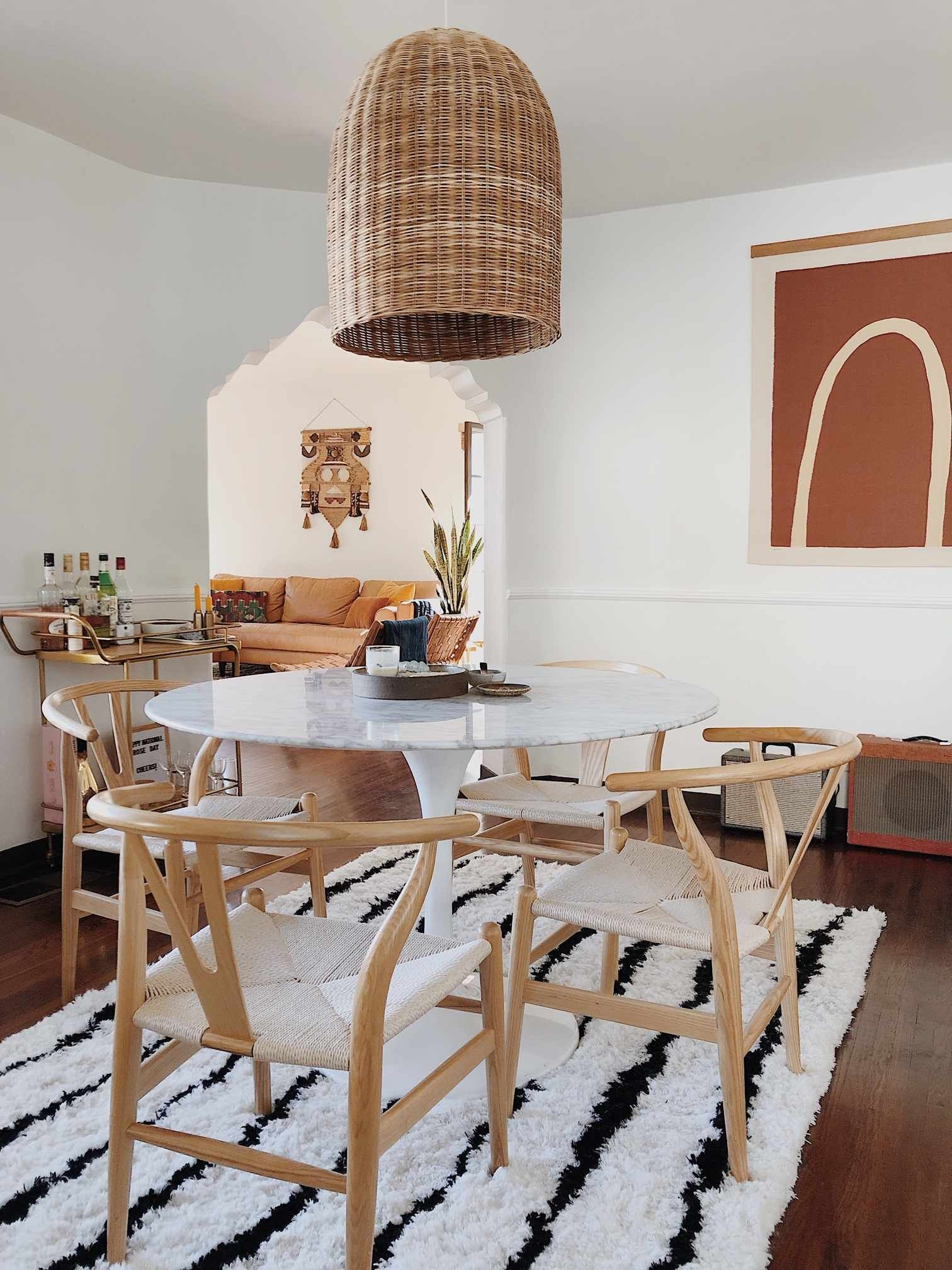 loving this bright and airy boho dining room decor this rattan light fixture is perfect on boho chic dining room kitchen dining tables id=14116