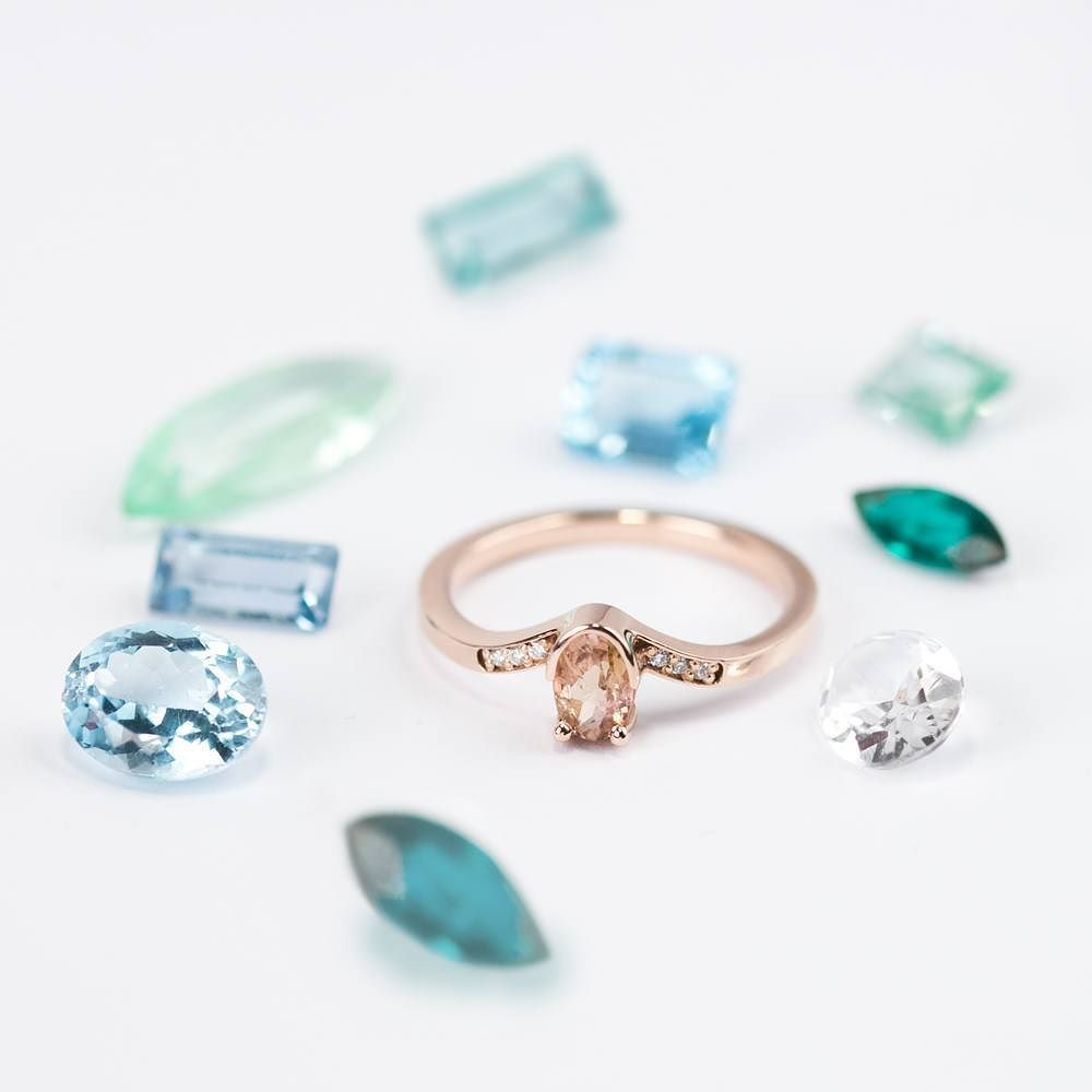 There's something about bi-color gemstones that intrigues us. How about you?