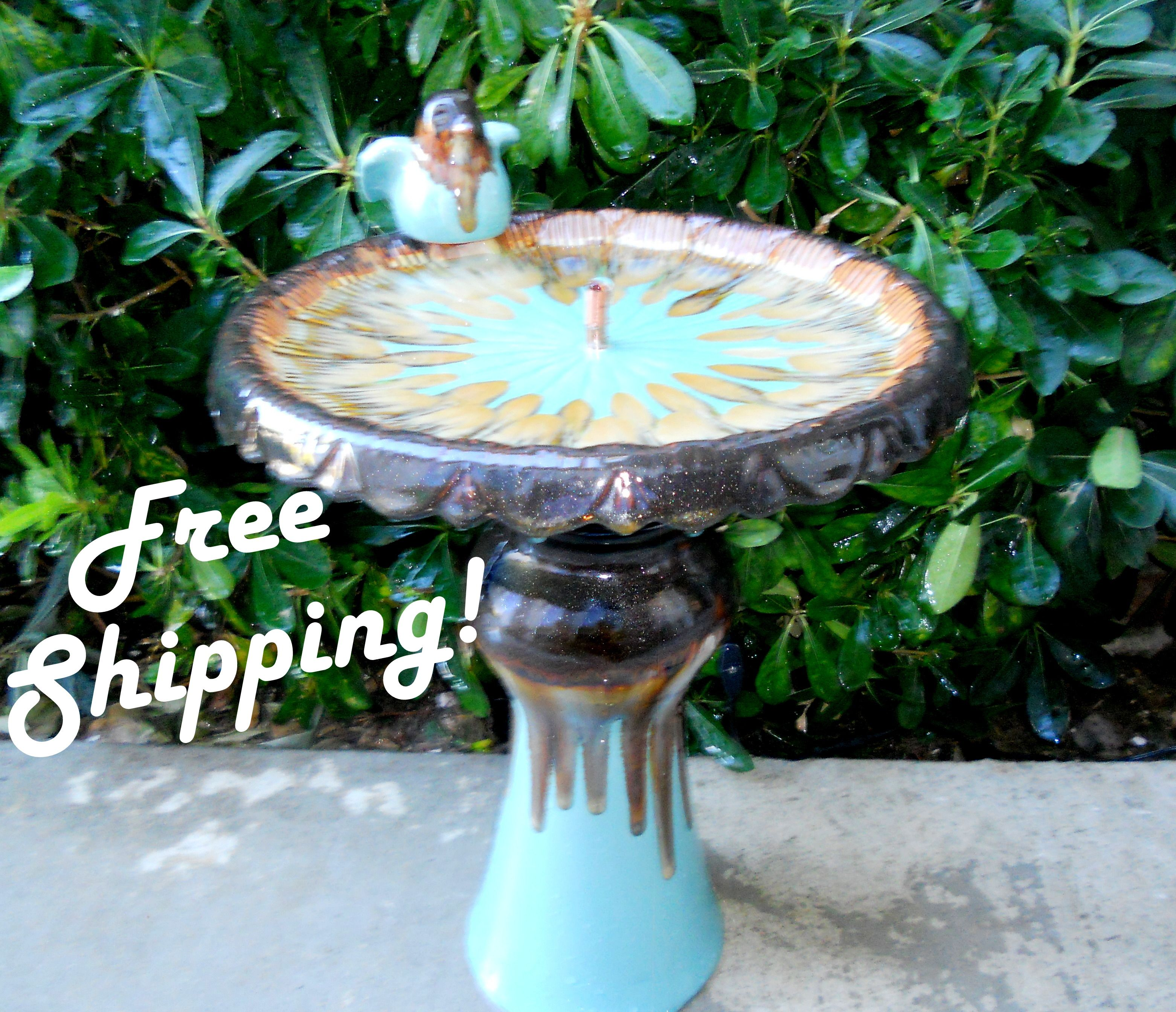 bird bath pedestal fountain in turquoise and brown