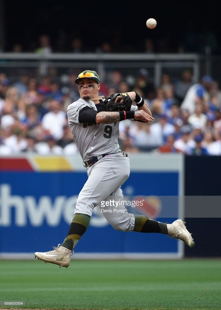sports shoes 97fd2 3a0ac Javier Baez  9 of the Chicago Cubs jumps as he throws to first base on a  single hit by Yangervis Solarte  26 of the San Diego Padres during the  fourth ...