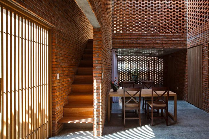 passively cooled termitary house in vietnam is wrapped in perforated