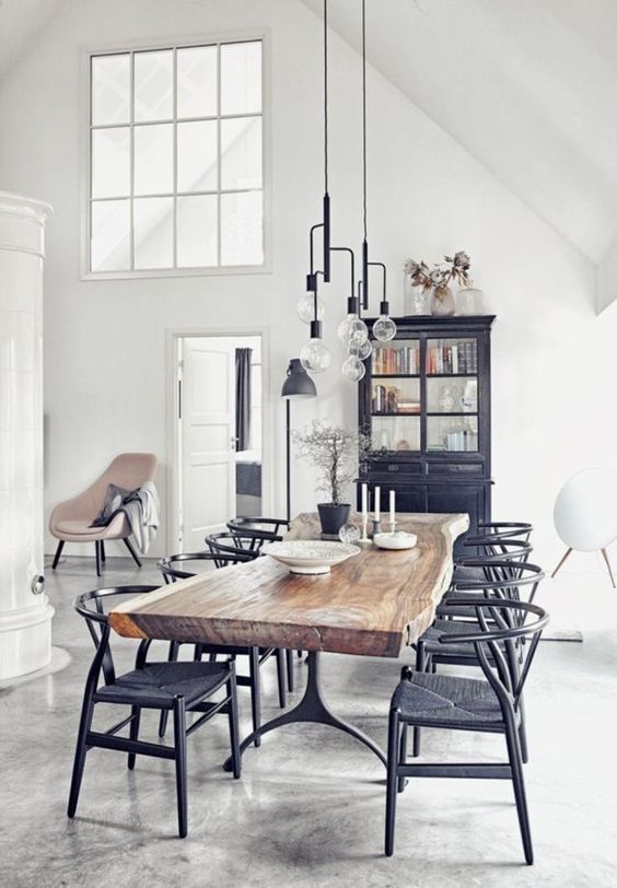 Scandinavian minimal dining room | farmhouse style table | wishbone chairs | industrial style light pendants | white high arched ceilings | polished concrete floors