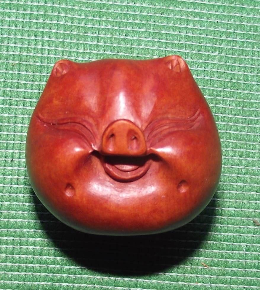 Cute pig netsuke. Simple design but full of character :)