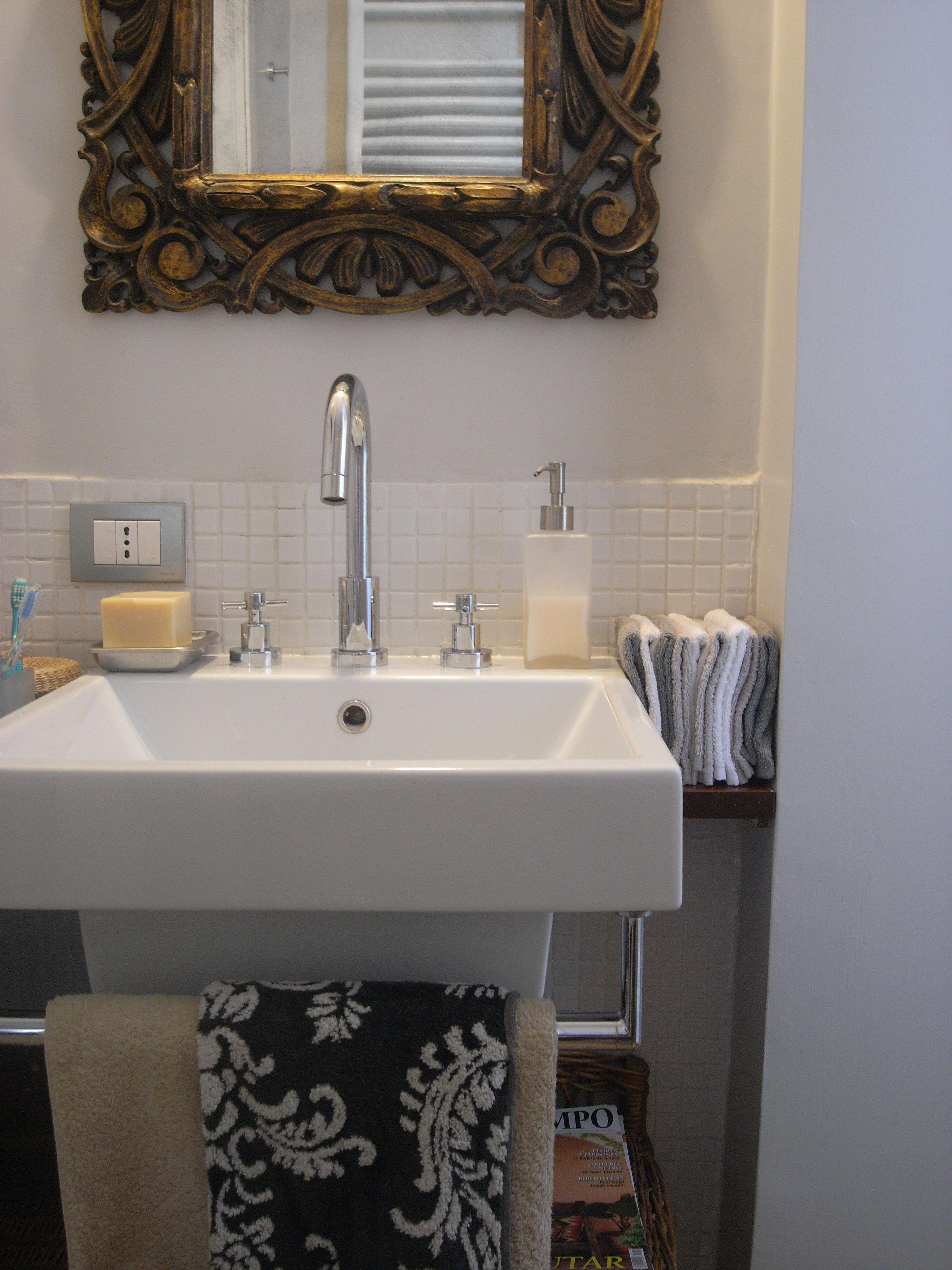 Catalano Sink And Antique Mirror 1700 In A Small Elegant Bathroom