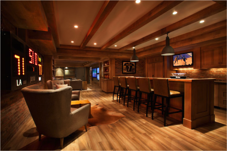 beautiful man cave with wood floor and bar