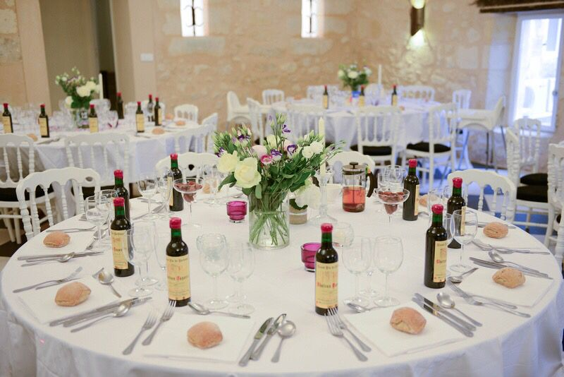 Round Tables With A Simple Case And As Favors Half Wine Bottles