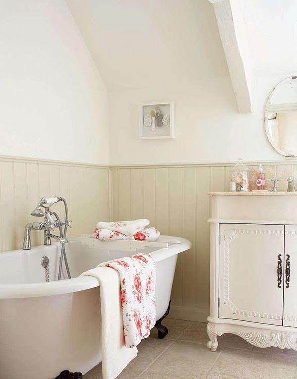 Country cottage bathroom with a claw foot bath tub -   www