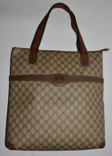 e124d670900 Authentic vintage Gucci tote in brown with ribbon straps made in 80s. GG  canvas is
