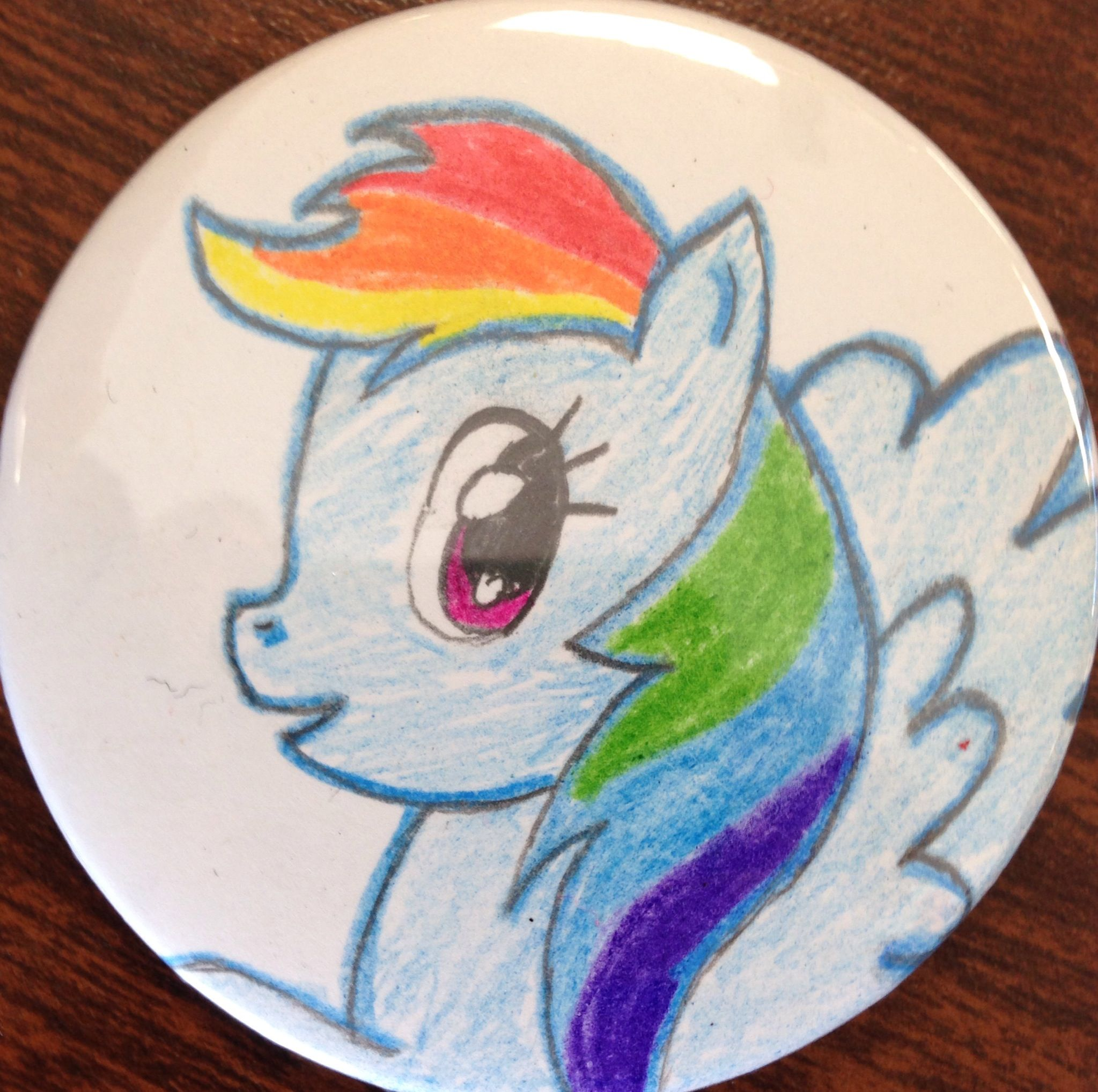 I was manning a button booth and a chick wanted me to draw a Rainbow Dash pin, so I did. But I thought I did such a nice job I wanted to keep it for myself.