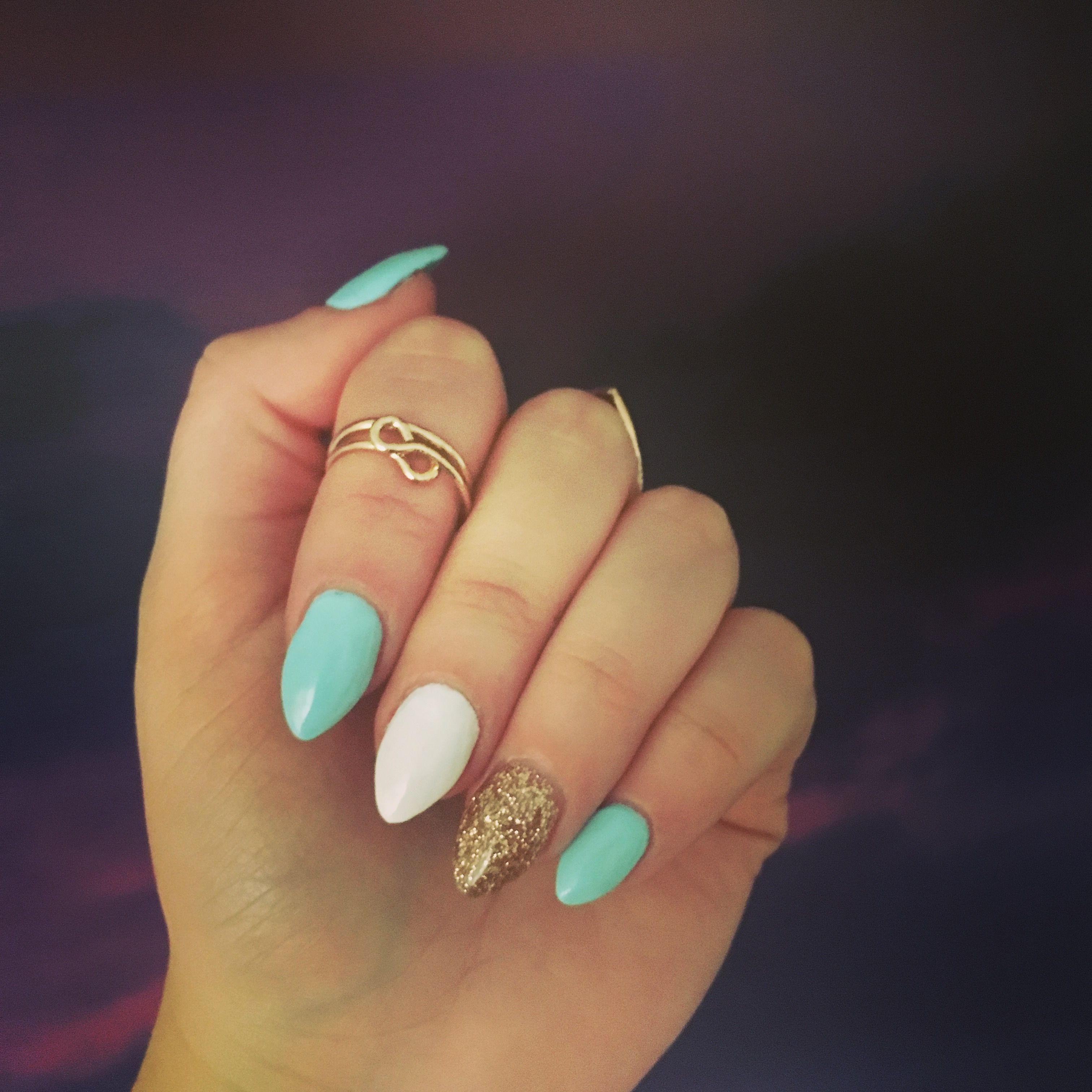 white gold and teal almond nails