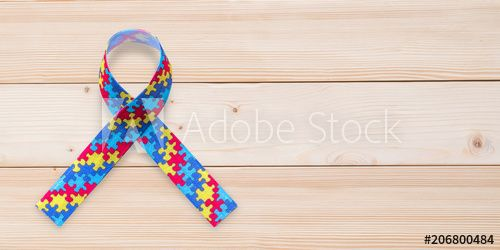 Autism awareness ribbon in puzzle or jigsaw pattern (isolated on wood background with clipping path) for World Autism Awareness day, mental health care concept for autistic child person support - Buy this stock photo and explore similar images at Adobe Stock