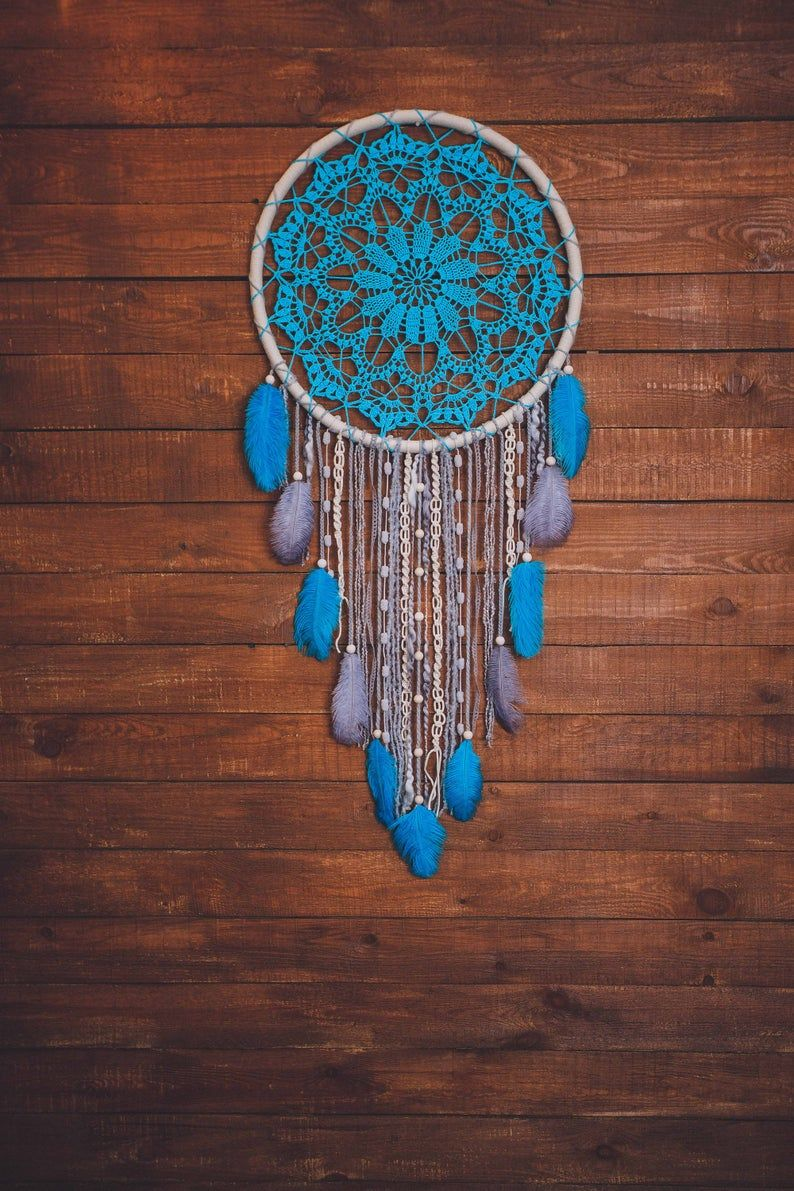 Would this blue boho dream catcher wall hanging melt your heart? Absolutely. This is a beautiful handcrafted wall art piece that will bring peace and serenity to your bedroom. Consider this doily dream catcher, if are looking for a gift for a boho lover. Feather dreamcatcher for a dream bohemian home. Pure beauty.  #girlsroom #daughtergift #bohodreamcather #bohemiandecor #wallartgift
