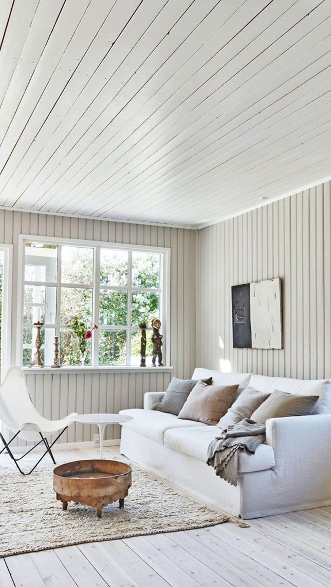 A living room with big windows. #Livingroom #Light #Whitecouch #Simple