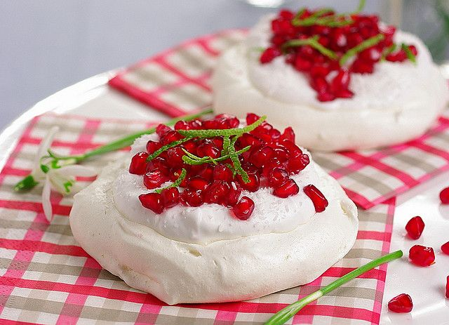 Such cheerfully hued pomegranate seed topped pavlovas (these would be gorgeous for Christmas!). #pavlova #meringue #dessert #food #fruit #red #white #Christmas #pomegranate