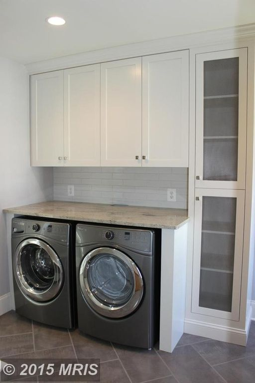 Contemporary Laundry Room With Travertine Tile Floors Ms
