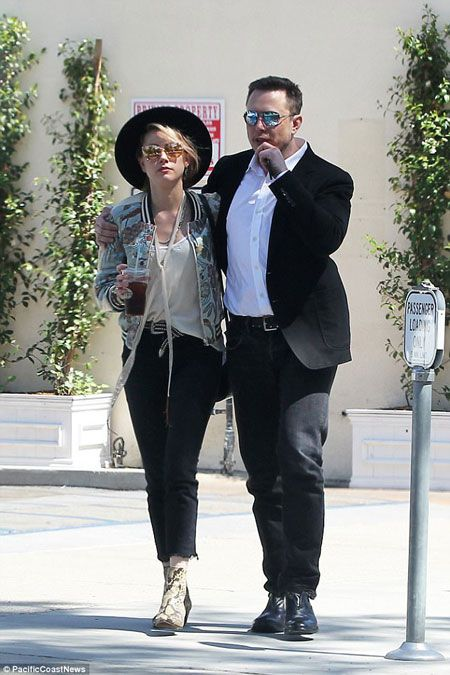 Party pals: Amber Heard was once again seen in the company of Elon Musk on
