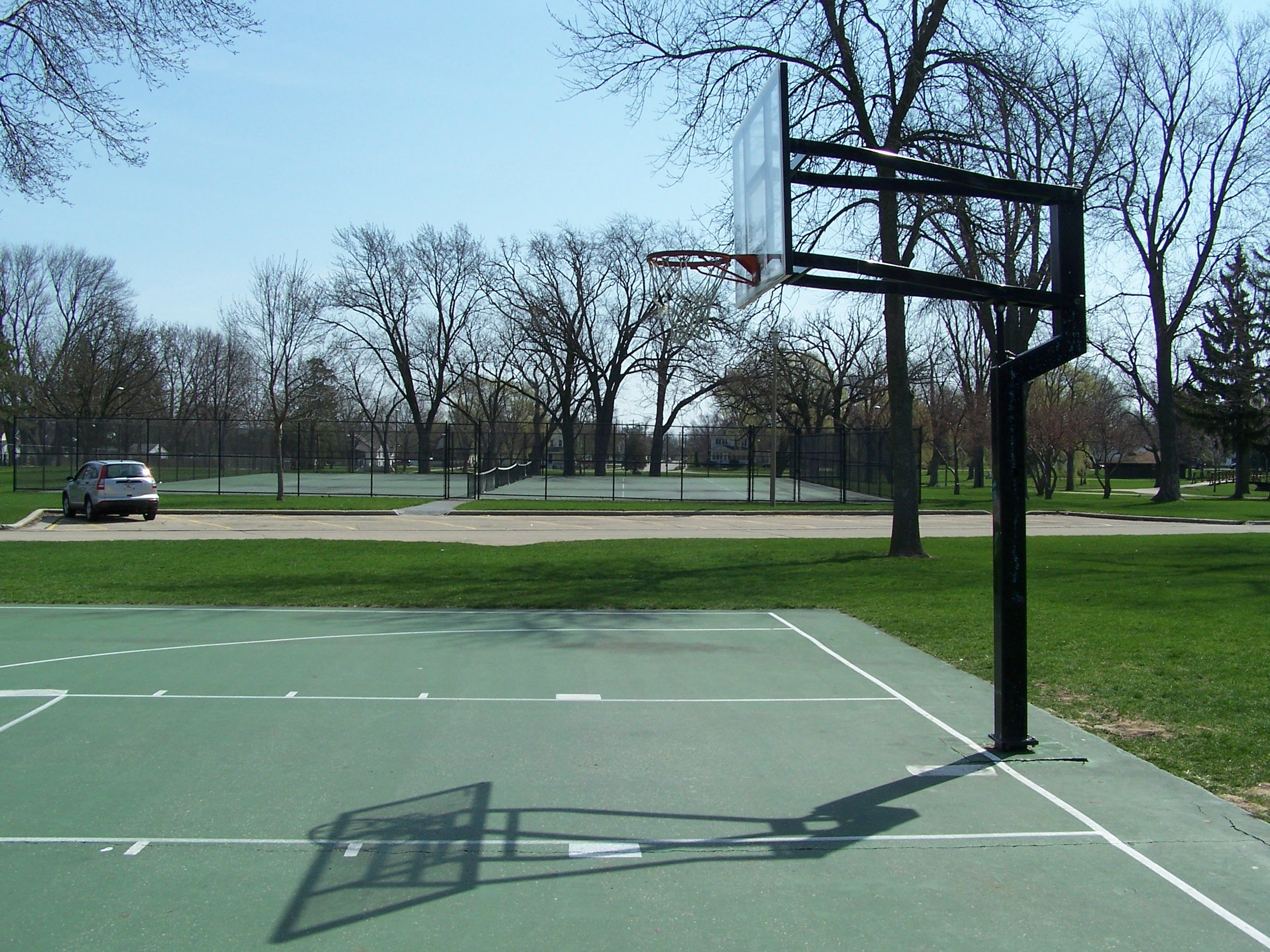 South Park Features A Basketball Court And Tennis Courts Park Parks Department Tennis Court
