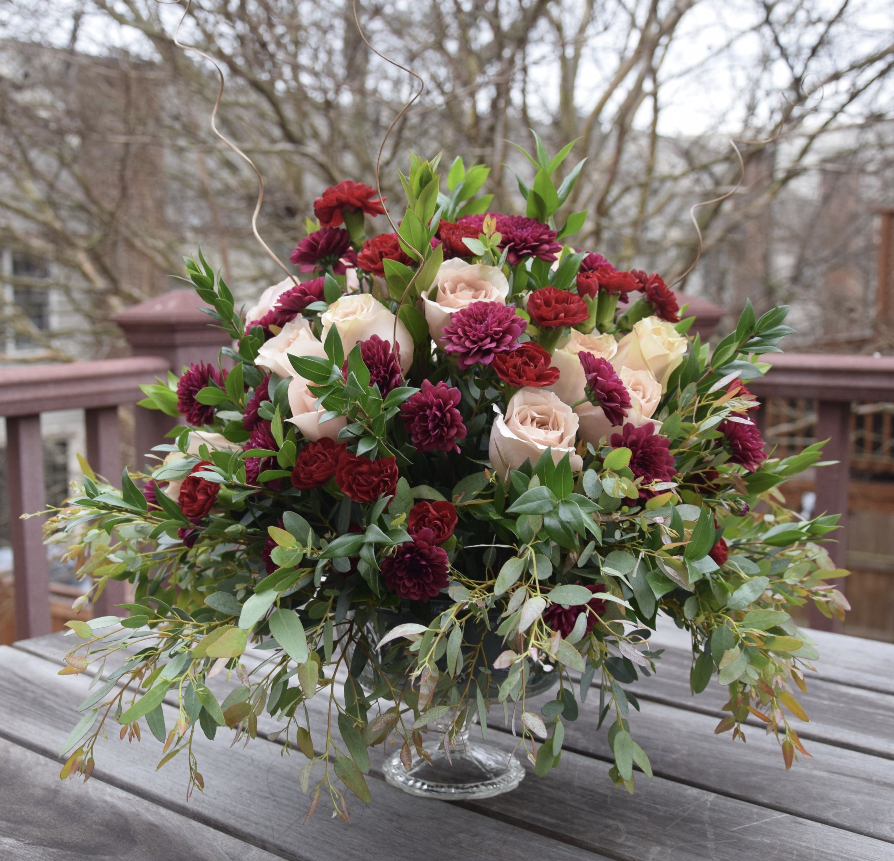 Table Centerpiece In Burgundy And Peach Colors. Wedding