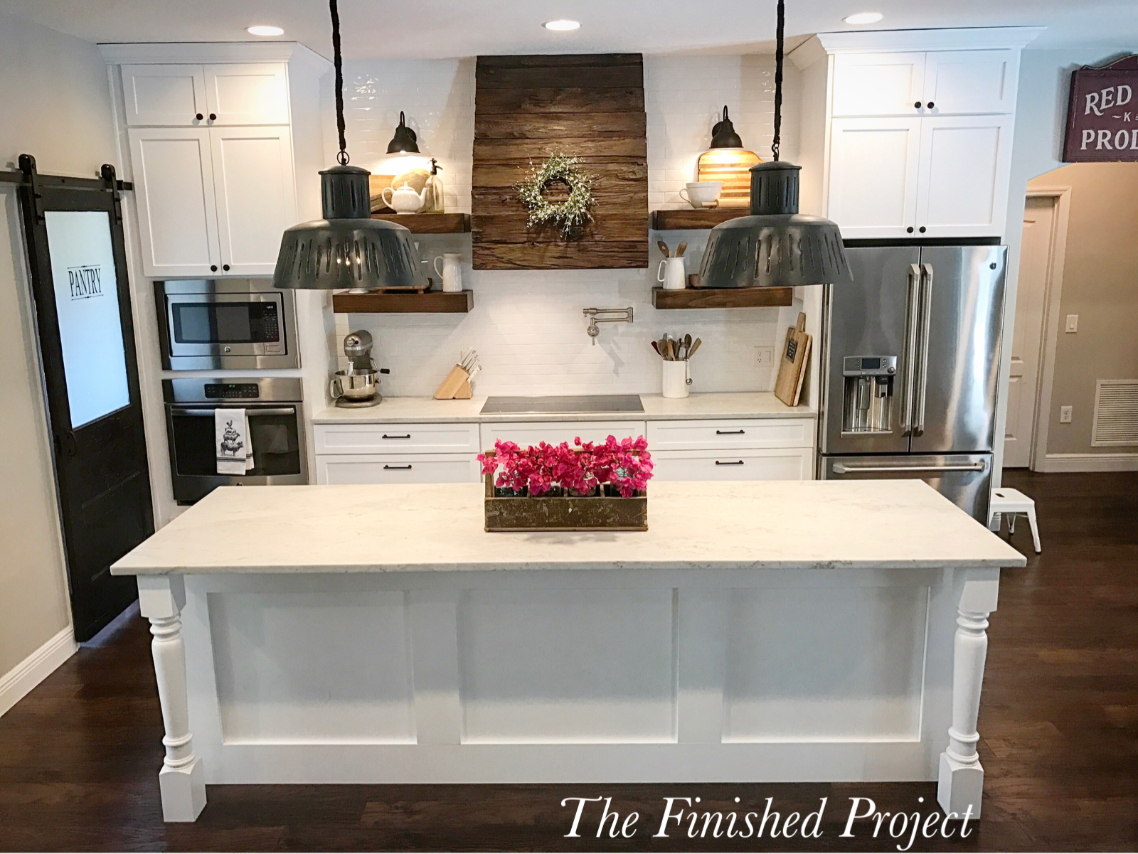farmhouse kitchen, white cabinets, wood vent hood, black pendant