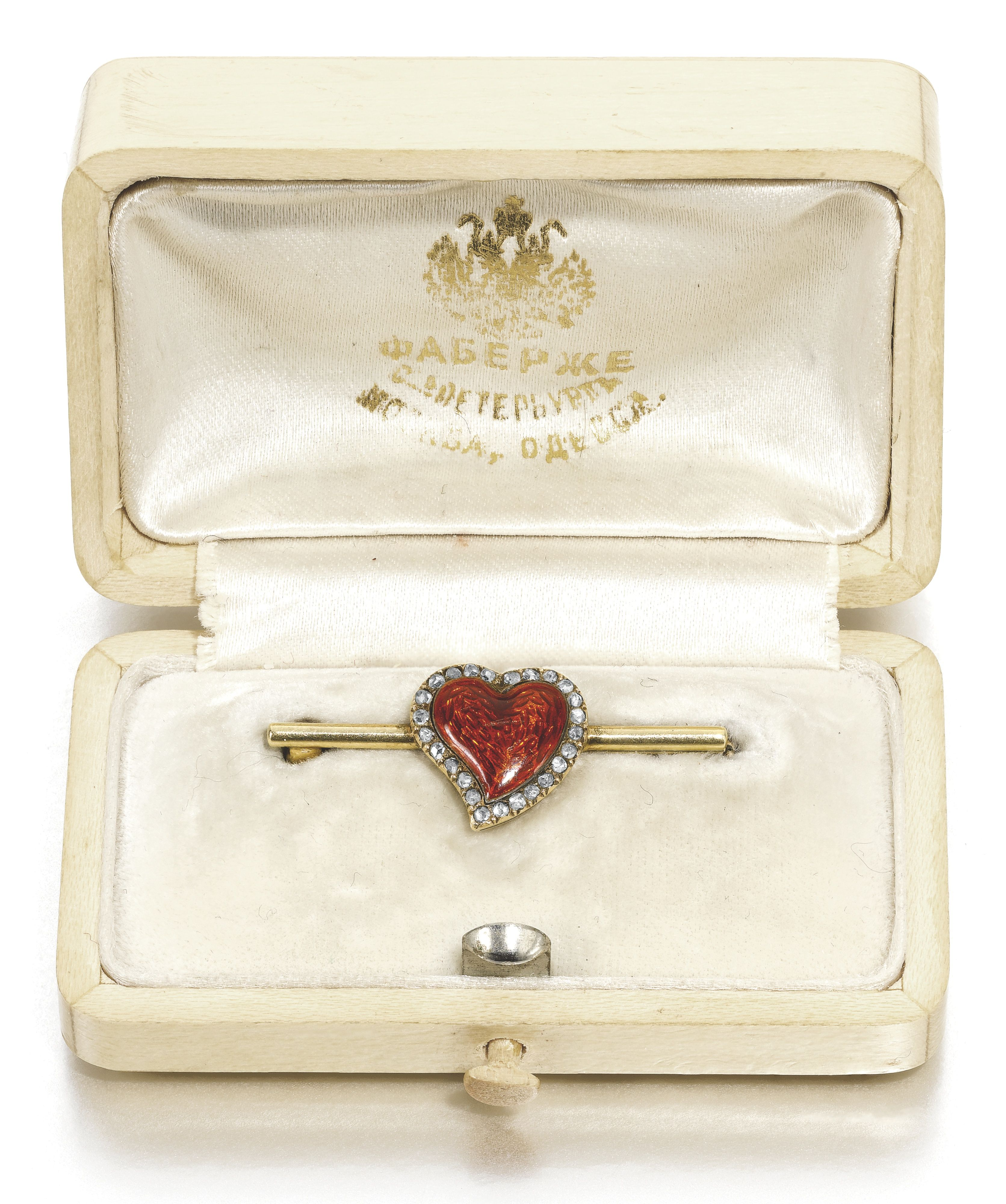 A Fabergé jewelled gold and enamel brooch, St Petersburg, 1899-1904, the gold bar centred with a translucent red enamel heart within a border of rose-cut diamonds.