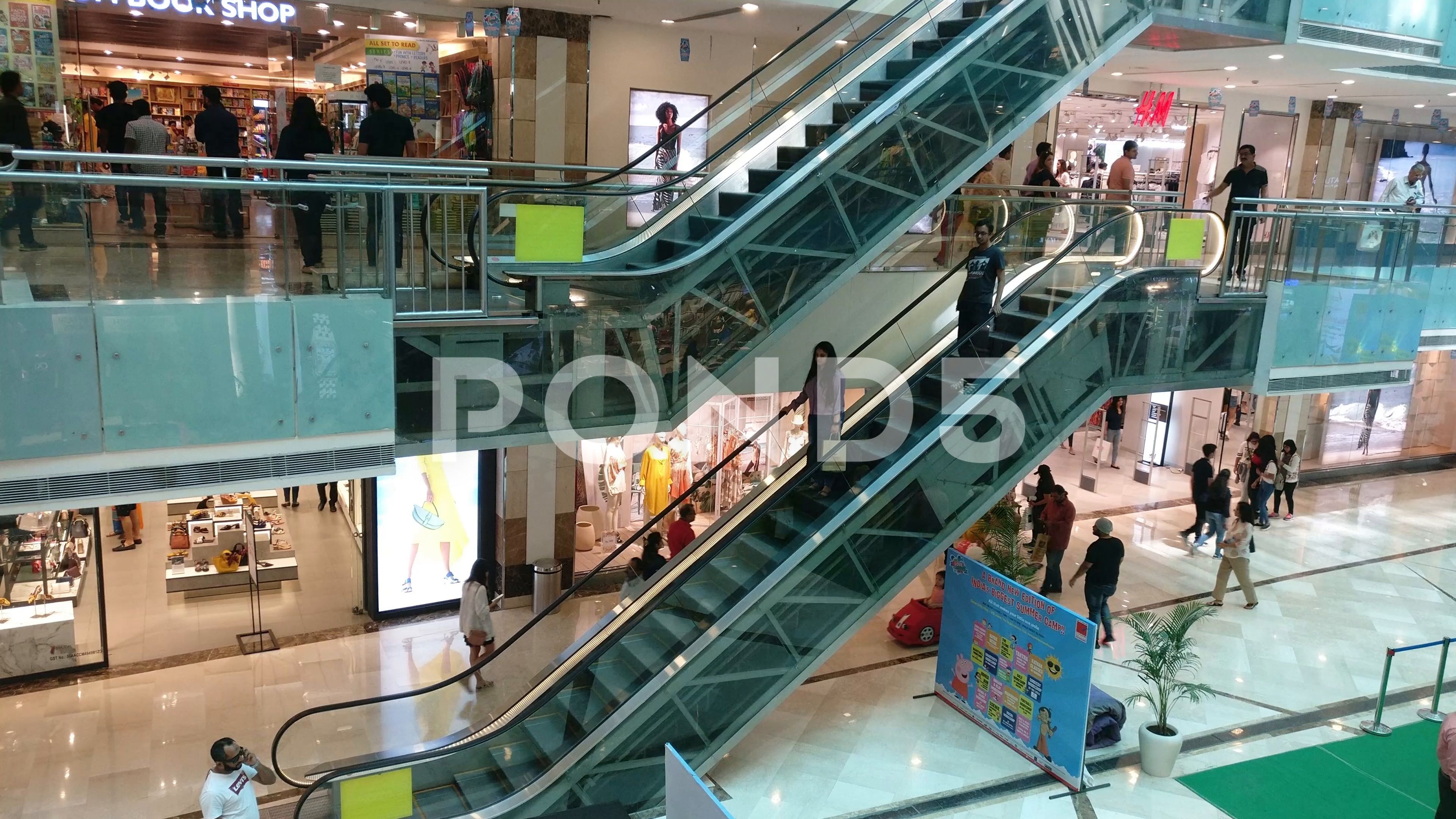 People Moving Down An Escalator In A Busy Shopping Mall In Gurgaon Delhi With Stock Footage Ad Busy Shopping Escalator People Shopping Mall Escalator Mall