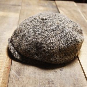 Generally Rogers newsboy caps are tweed but he gets rugged every now and then with a leather one. His mother has made him some knit-crocheted caps in the past that he'll wear for her.