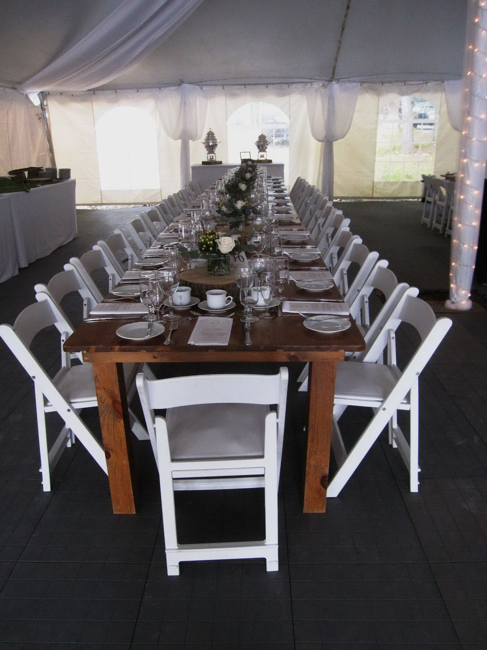 Harvest tables and white folding chairs