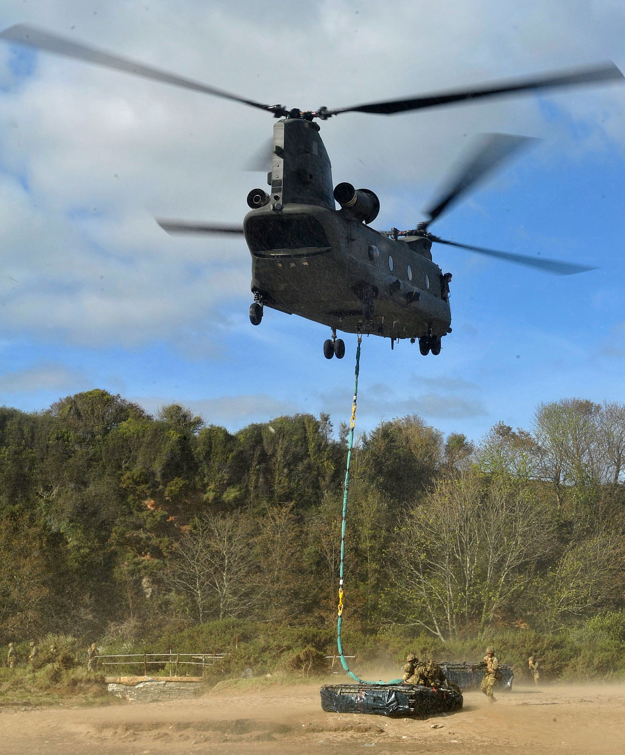 As part of a wader package, 3 Commando Brigade along with 4 Assault Squadron Royal Marines (4 ASRM), 29 and 24 Commando today conducted exercises using landing craft, hover craft and a Royal Air Force Chinook helicopter currently based on HMS Illustrious. The training happened at Carlyon Bay near St. Austell, Cornwall with civilian onlookers.