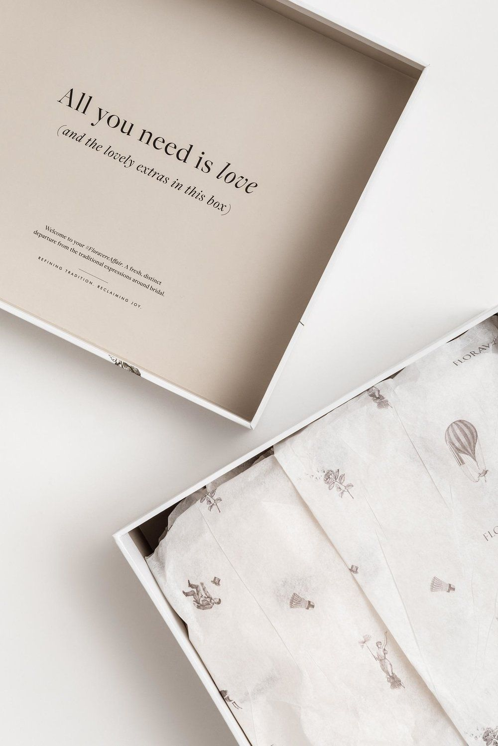 Add some printing on the inside for an extra little surprise. Don't forget that custom tissue paper.