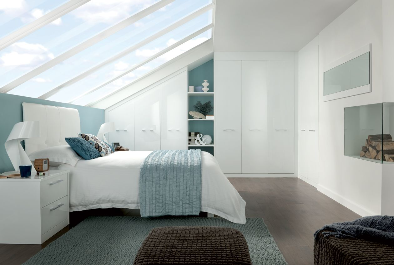 White loft bedroom ideas  This is a great use of a loft space that uses the bedroom furniture