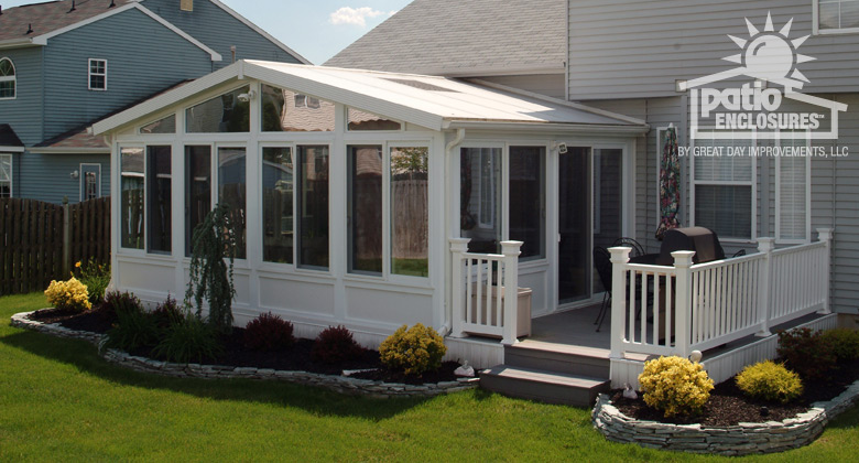 all season sunroom with white vinyl frame with gable roof and side