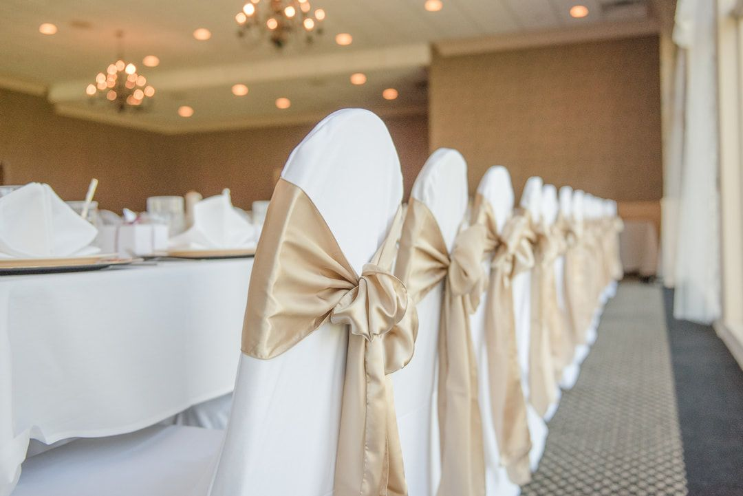 Wedding Day Decor Head Table With White Chair Covers And Gold