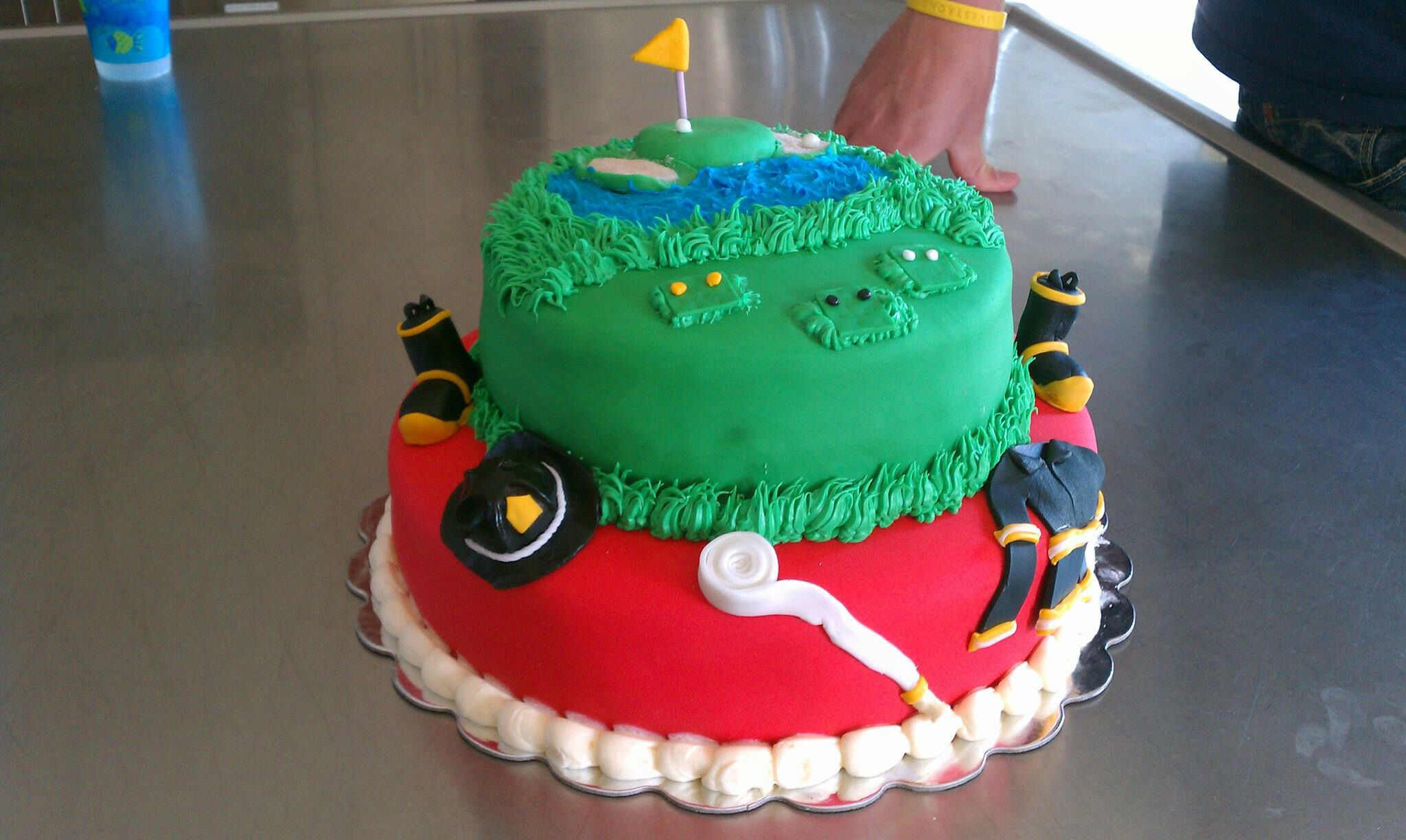 Firefighter/Golf Inspired Birthday Cake. All items sculpted with fondant.