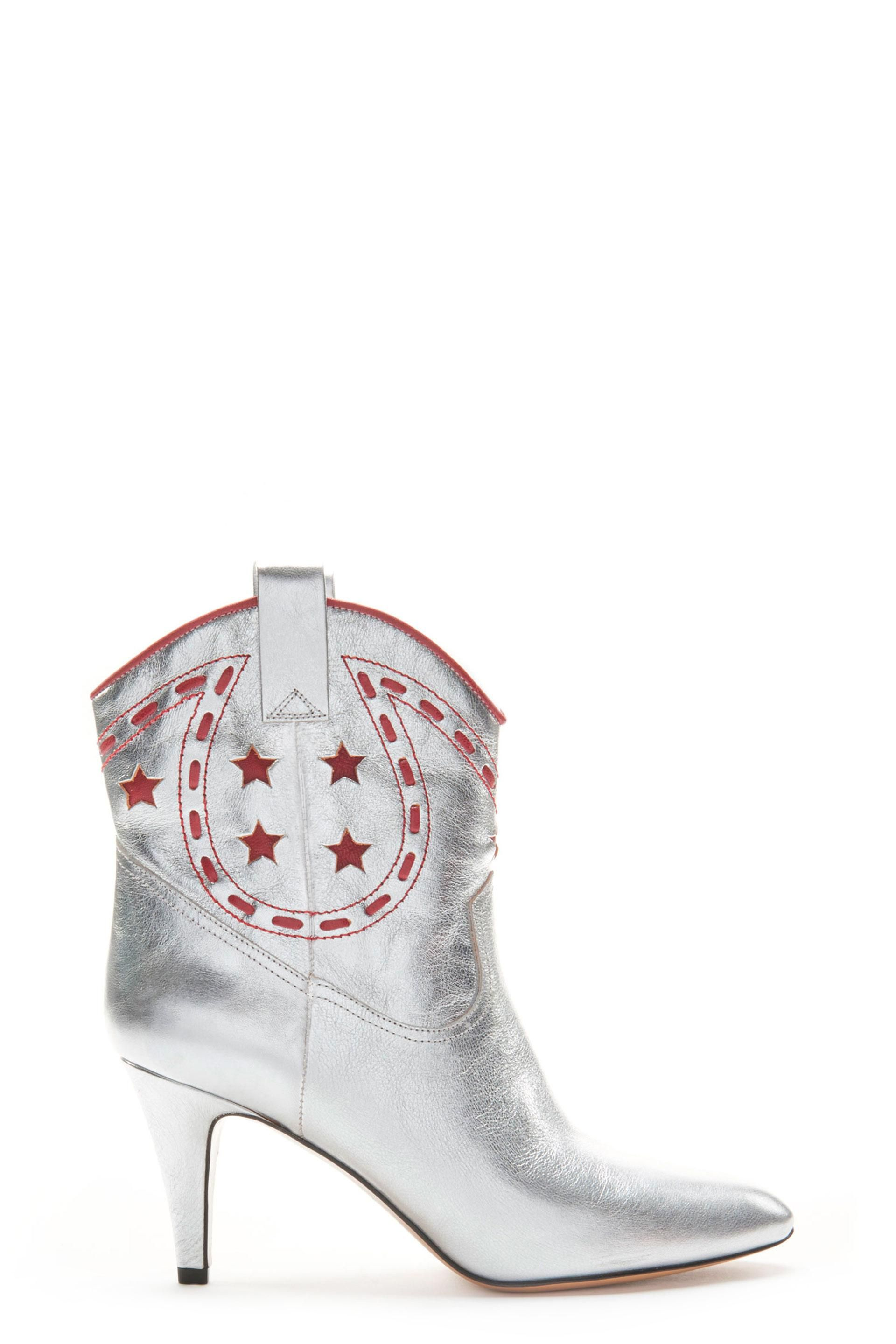 The Marc Jacobs Georgia Cowboy Boot is crafted from goat leather with a smooth finish and contrast stitch detail on the upper. The boot is a slip on with leather pull tabs on both sides. True cowboy boot silhouette with a pointed toe. Heel: 75MMHalf sizes available from 35-41.100% Goat Leather