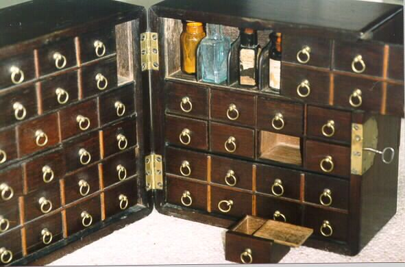 This page of Medical Antiques shows a variety of antique apothecary cabinets  and drug kits. - An English, C.1810 Apothecary Cabinet Or