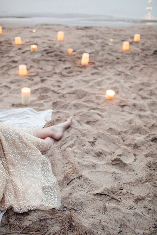 Pillar Candles Scattered over the Beach for a Romantic Seaside Wedding | Megan Robinson Photography | See More! http://heyweddinglady.com/se...