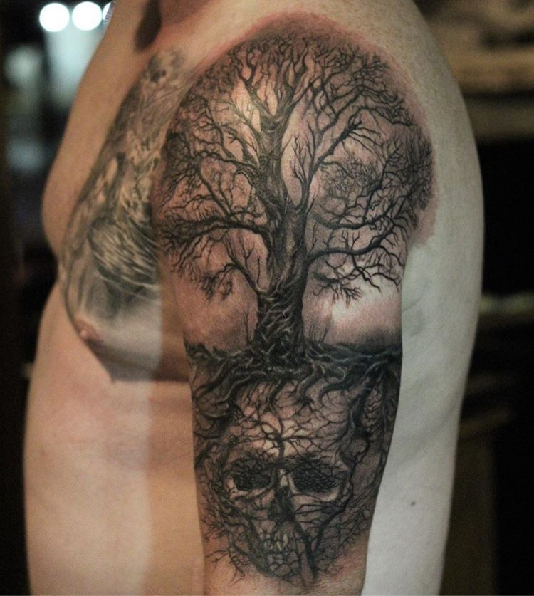 Photo of Tatouage réaliste d'arbre et de crâne noir et gris par Francisco Sanchez à Dark Age …