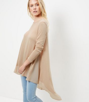 """Add a feminine touch to your everyday look with this chiffon panel dip hem top. Team with skinny jeans and block heel ankle boots to complement.- Chiffon fabric panel- Dip hem- Fine knit- Rounded neckline- Simple long sleeves- Casual fit that is true to size- Cara is 5'9""""/175cm and wears UK 10/EU 38/US 6"""